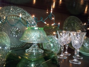 Green dishes and crystal with lights