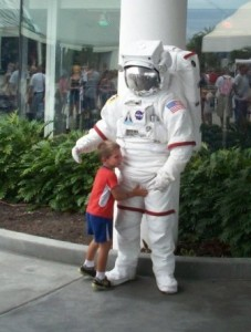 Boy hugs space man